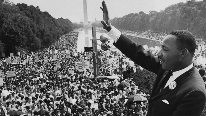 Dr. Martin Luther King Jr. acknowledges the crowd at the Lincoln Memorial for his